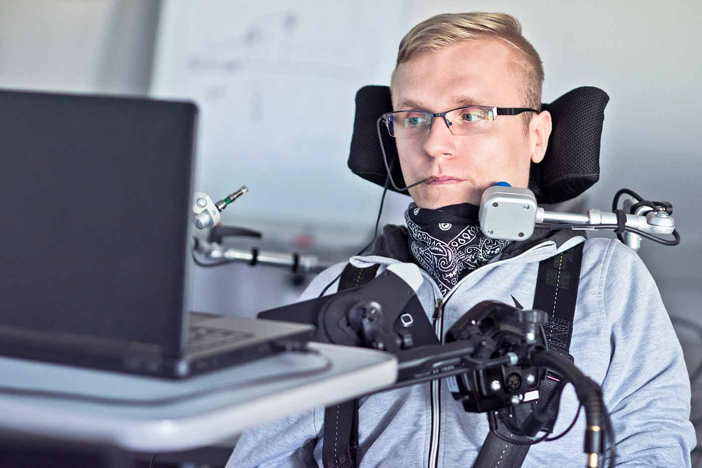 Disabled Man Using Computer with Assistive Devices